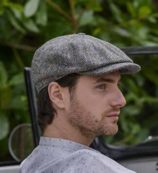 Tweed driving cap. Imported from Ireland.